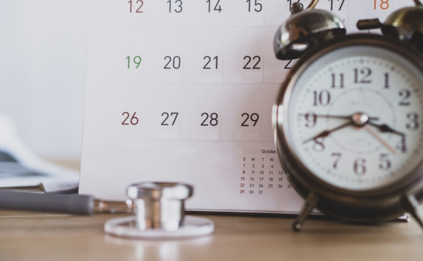 calendar with clock and stethoscope